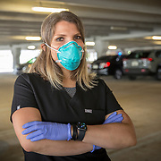 A nurse is seen for appointment only testing for Coronavirus (Covid-19) in the University of Central Florida parking garage lot A on Monday, April 6, 2020 in Orlando, Florida. (Alex Menendez via AP)