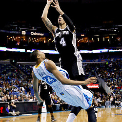 Jan 7, 2013; New Orleans, LA, USA; New Orleans Hornets power forward Anthony Davis (23) draws a charge from San Antonio Spurs shooting guard Danny Green (4) during the second quarter of a game at the New Orleans Arena. Mandatory Credit: Derick E. Hingle-USA TODAY Sports