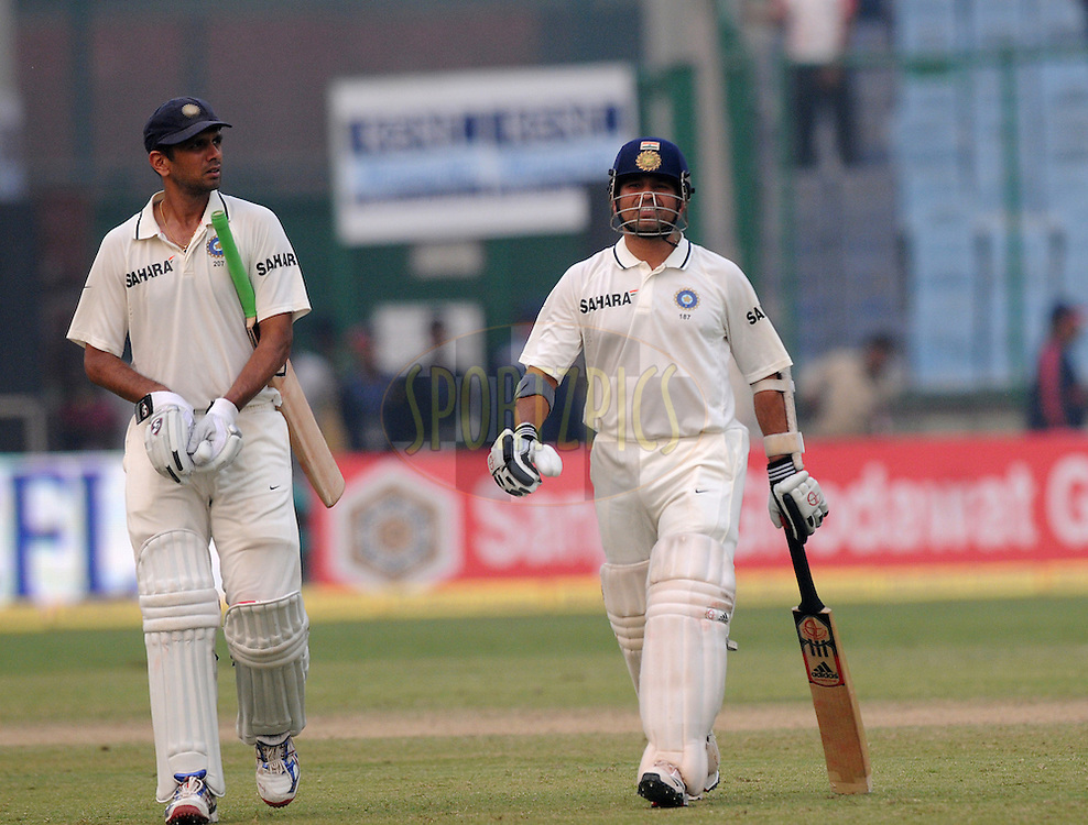 Sachin Tendulkar of India and Rahul Dravid of India walk back after the days play during the 3rd day of the 1st test match between India and The West Indies held at  the The Feroz Shah Kotla Stadium, Delhi on the 8th November 2011..Photo by Pal Pillai/BCCI/SPORTZPICS