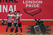 Neal Maupay (Brentford) celebrating his goal with Said Benrahma (Brentford) & Rico Henry (Brentford) during the EFL Sky Bet Championship match between Brentford and Derby County at Griffin Park, London, England on 6 April 2019.