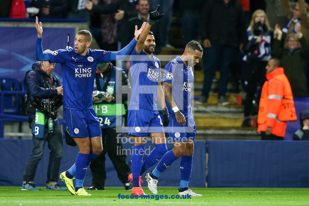 Riyad Mahrez of Leicester City (centre) celebrates with his team mates after scoring during the UEFA Champions League match at the King Power Stadium, Leicester<br /> Picture by Andy Kearns/Focus Images Ltd 0781 864 4264<br /> 18/10/2016