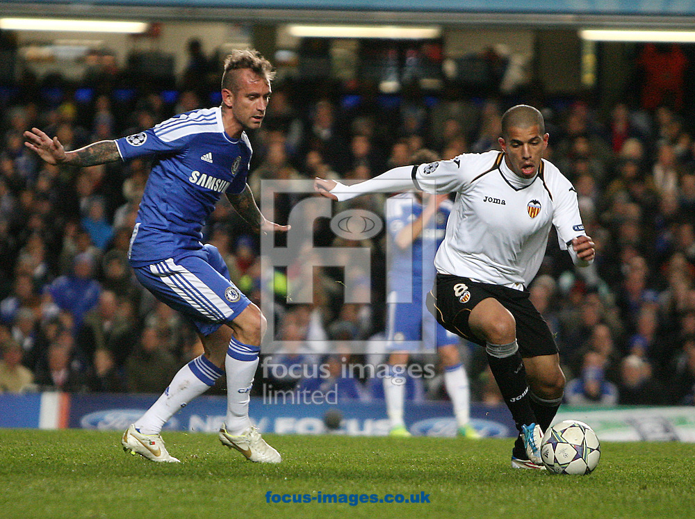 Picture by Paul Terry/Focus Images Ltd. 07545642257.6/12/11.Sofiane Feghouli of Valencia goes past Raul Meireles of Chelsea during the UEFA Champions League match at Stamford Bridge stadium, London.
