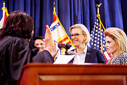May 1, 2019 - Tampa, Florida, U.S. - Mayor JANE CASTOR smiles with her partner ANA CRUZ takes the oath of office from Mayor of Tampa by U.S. District Judge MARY SCRIVEN on Wednesday at Armature Works on Wednesday. (Credit Image: © Jones/Tampa Bay Times via ZUMA Wire)