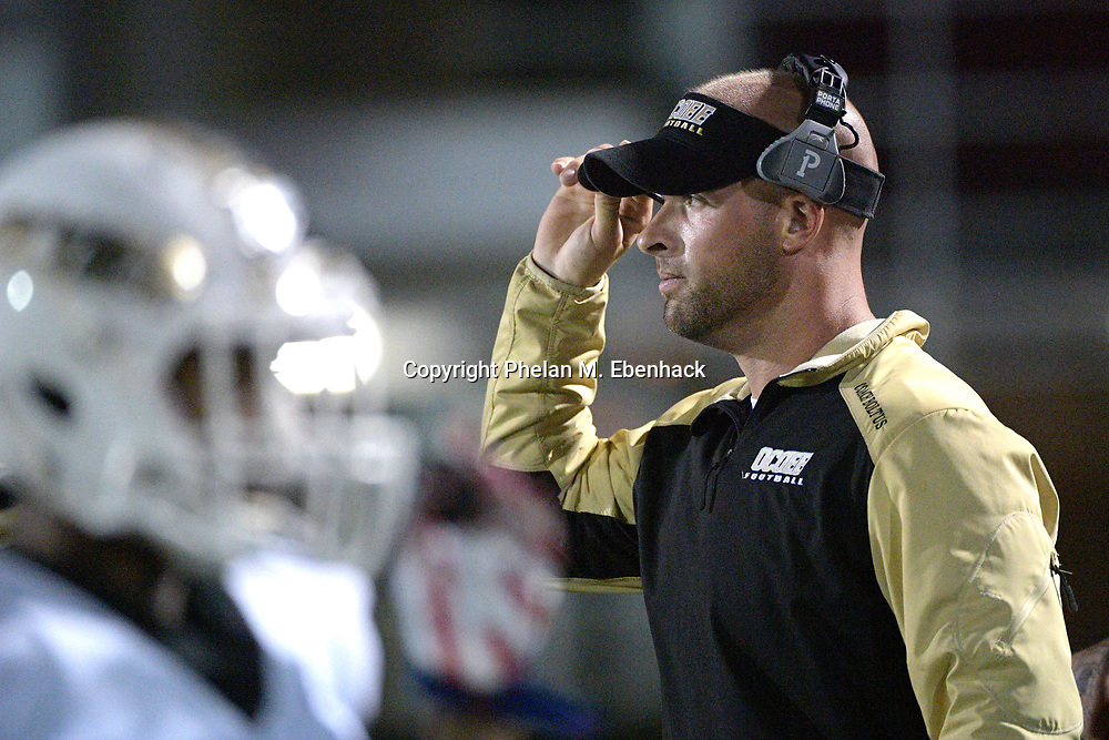 Ocoee head coach Jason Boltus watches from the sideline during the second half of a high school football game against Edgewater Monday, Oct. 9, 2017, in Orlando, Fla. Edgewater won 44-29. (Photo by Phelan M. Ebenhack)