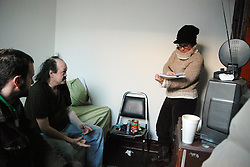 "IPTC Caption:		USA, IL, Chicago, December 28, 2010.  Working in tandem, social worker Anne Leto from Health & Disability Advocates and Eric Swiecki from Thresholds assess the needs of ""Jesse,"" off the winter streets of Chicago for the first time in  twenty years. HDA is one of the only agencies entitled to provide ""presumptive benefits"" to candidates in serious trouble, enabling them to begin immediate assistance while paperwork is completed. Homeless people are often unable to provide the documentation they need for any kind of service. In a process that began more than a year ago, Thresholds staff were able to finally determine ""Jesse's"" identity. One of their mental health teams will now monitor his gradual re-entry into society, while HDA, which unites legal and health experts, will ensure his benefits are administered."