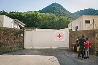COMO, ITALY - 21 JUNE 2017: East African migrants are seen here at the Red Cross reception center in Como, Italy, on June 21st 2017.<br /> <br /> Residents of Como are worried that funds redirected to migrants deprived the town's handicapped of services and complained that any protest prompted accusations of racism.<br /> <br /> Throughout Italy, run-off mayoral elections on Sunday will be considered bellwethers for upcoming national elections and immigration has again emerged as a burning issue.<br /> <br /> Italy has registered more than 70,000 migrants this year, 27 percent more than it did by this time in 2016, when a record 181,000 migrants arrived. Waves of migrants continue to make the perilous, and often fatal, crossing to southern Italy from Africa, South Asia and the Middle East, seeing Italy as the gateway to Europe.<br /> <br /> While migrants spoke of their appreciation of Italy's humanitarian efforts to save them from the Mediterranean Sea, they also expressed exhaustion with the country's intricate web of permits and papers and European rules that required them to stay in the country that first documented them.