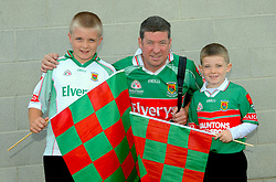 Mayo supporters Adam and Ben Killeen with dad John from Balla amoung the Mayo supporters at McHale Park on saturday last.<br /> Pic Conor McKeown