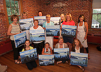 The Wine and Design group with the finished paintings at the Belknap Mill Tuesday evening.  l-r first row Katharine Kurdziel, Molly Moynihan, Beth San Soucie, Muff Kruse.  l-r second row Kay Anderson, Kathy Bagley, Susan Finn, Janet Wronski, Kate Criscone. l-r back row Becky Guyer, Denise Sharlow and Debbie Frawley Drake.  (Karen Bobotas/for the Laconia Daily Sun)