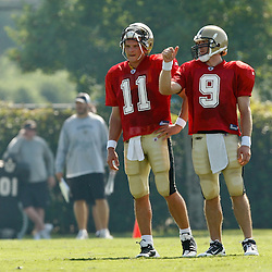 July 31, 2010; Metairie, LA, USA; New Orleans Saints quarterback Drew Brees (9) talks with backup quarterback Patrick Ramsey (11) during a training camp practice at the New Orleans Saints practice facility. Mandatory Credit: Derick E. Hingle