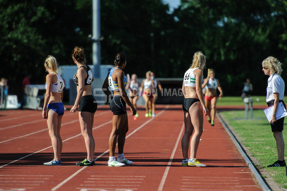 Megan Rogers (Swansea) in lane 1 waits to receive the baton from Rebecca Williams during the 4 x 400m relay, UK Women's Athletics League - Premier Division Match 3, Norman Park Bromley, UK on 03 August 2013. Photo: Simon Parker