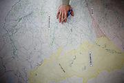 Minamisoma, April 28 2011 - .(Eng) A city hall employee shows on a map the three different areas in MinamiSoma. The city, 70,000 inhabitants, is divided in two by the evacuation zone border, 20km from the plant..The yellow part is the new evacuation zone, outside  the initial evacuation zone. This area had to be evacuated before the end of May 2011...(Fr) Un employé municipal montre les limites des différentes zones d'évacuation. La ville de Minamisoma, 70 000 habitants,  est coupée en deux par la ligne de démarcation de la zone d'exclusion des 20km. En jaune, la nouvelle zone d'exclusion en dehors des 20km, a evacuer avant fin mai 2011. Le gouvernement japonais n'avait pas anticipé les retombées radioactives dues aux vents et à la neige quelques jours après le 11 mars. Ces retombées ont pollué les sols jusqu'à plus de 40km de la centrale.