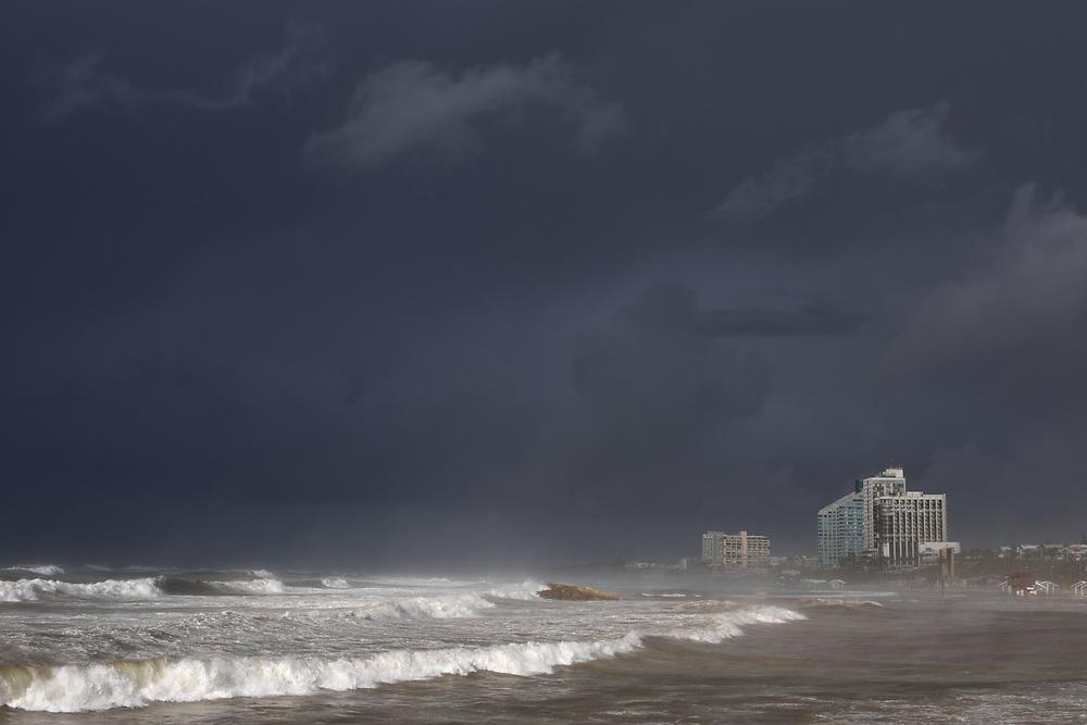 Waves break on the beach in the Israeli coastal city of Herzliya on January 05, 2018 as a storm hits the country. Photo by Gili Yaari