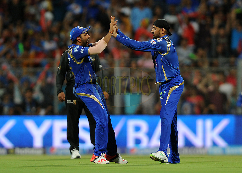 Rohit Sharma captain of Mumbai Indians celebrates the wicket of  Murali Vijay of Kings XI Punjab during match 7 of the Pepsi IPL 2015 (Indian Premier League) between The Mumbai Indians and The Kings XI Punjab held at the Wankhede Stadium in Mumbai, India on the 12th April 2015.<br /> <br /> Photo by:  Pal Pillai / SPORTZPICS / IPL