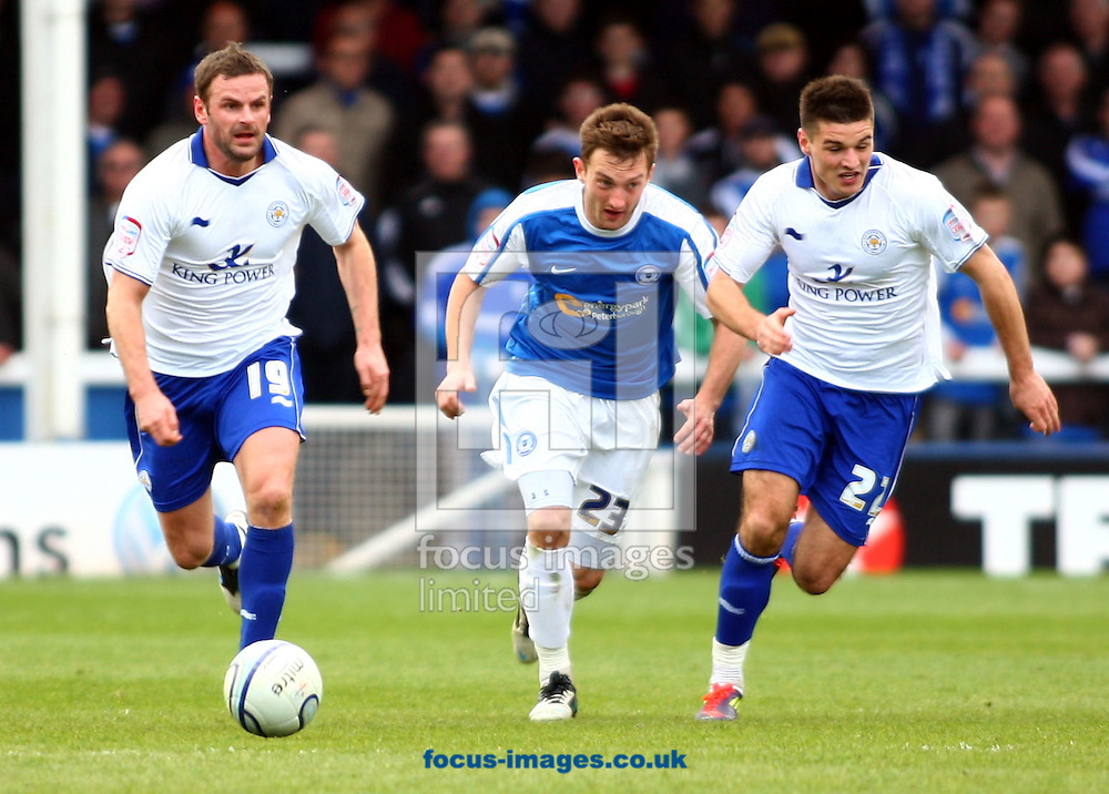 Picture by Rob Fisher/Focus Images Ltd. 07545 398891.31/03/12.Lee Frecklington (centre) of Peterborough United is sandwiched by Richie Wellens (L) and Ben Marshall (R) of Leicester City during the Npower Championship match at London Road stadium, Peterborough.