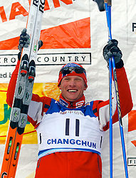 CHANGCHUN, CHINA - SUNDAY, FEBRUARY 25th, 2007: Hetland Tor Arne of Norway celebrates after winning the bronze medal in the men's 1.2 km sprint race at the 2007 FIS World Cup cross-country skiing event. (Pic by Osports/Propaganda)
