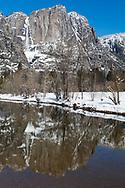 Yosemite Falls is reflected in the calm water below, Yosemite National Park, CA.