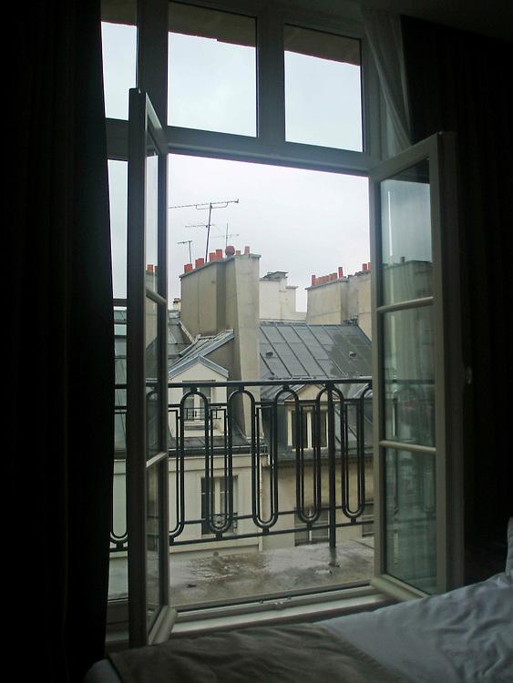 open window Paris rooftops