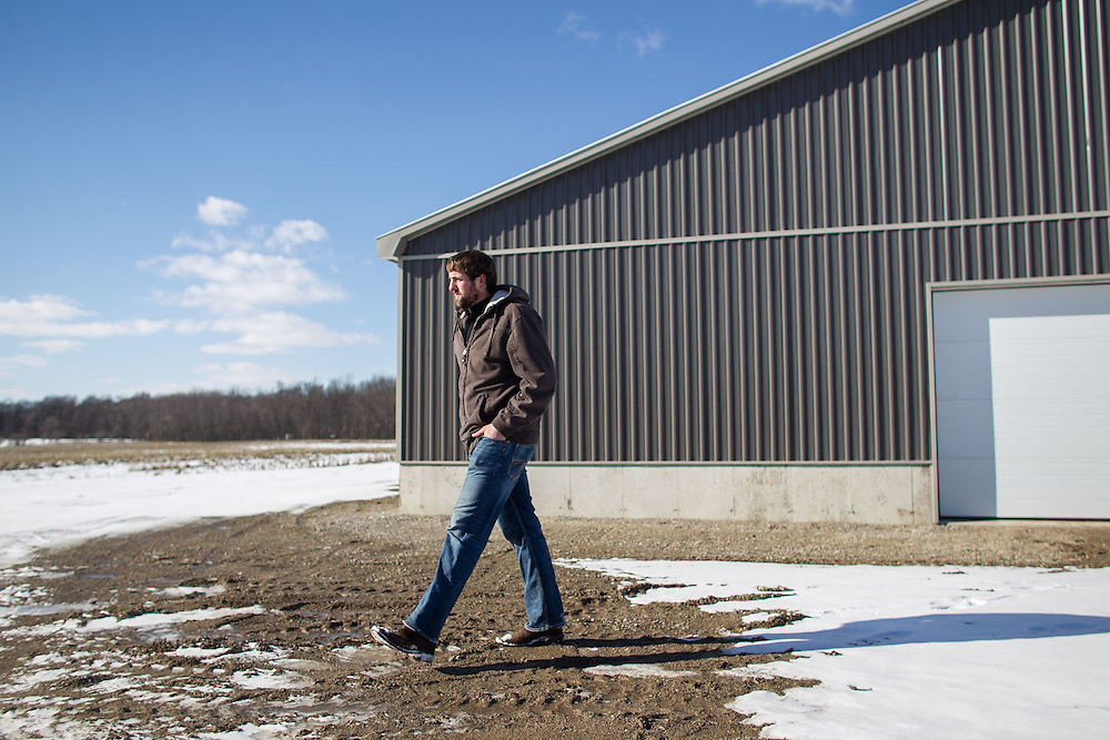 Jonathan Giret walks by his barn at his farm near West Lorne, Ontario, Thursday, February 2, 2017.<br /> Farmers Forum/ Geoff Robins