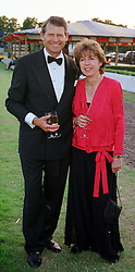 Leading polo figures MR & MRS PETER GRACE, at a ball in London on 23rd July 1999.MUK 42