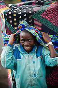 An internally displaced boy carries a mattress on his head in the Kibati IDP camp on the outskirts of Goma, Eastern Democratic Republic of Congo on Friday December 12, 2008