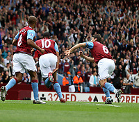 Photo: Mark Stephenson.<br /> Aston Villa v Everton. The FA Barclays Premiership. 23/09/2007.Aston Villa's John Crew  (no 10 ) celebrates his goal for 1-0 witjh team mates Gareth Barry (R) and Luck Moore