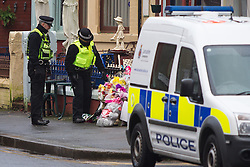 © Licensed to London News Pictures . Blackpool , UK . 04/02/2013 . Police officers examine tributes and flowers outside the Grafton House Hotel , Kirby Road , Blackpool today (4th February 2013) where Sasha Marsden was found murdered , as David Minto is due before Magistrates , charged with the murder of the 16 year old this morning (4th February 2013) . Photo credit : LNP