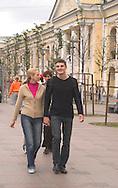 A young Russian couple walking on<br /> Nevsky Prospect<br /> St. Petersburg, Russia<br /> c. Ellen Rooney<br /> c. Ellen Rooney