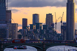 © Licensed to London News Pictures. 18/11/2019. London, UK. Sunset over the Thames towards Westminster Bridge and Vauxhall Cross as the Met Office issue a yellow weather warning for freezing fog with disruption to transport tomorrow as temperatures are set to tumble to -2 in the London area . Photo credit: Alex Lentati/LNP