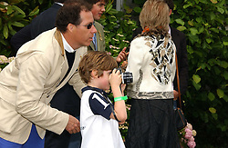 """LORD LINLEY teaching his son the HON.CHARLES ARMSTRONG-JONES how to take photographs at the Goodwood Festival of Speed on 9th July 2006.  Cartier sponsored the """"Style Et Luxe' for vintage cars on the final day of this annual event at Goodwood House, West Sussex and hosted a lunch.<br /><br />NON EXCLUSIVE - WORLD RIGHTS"""