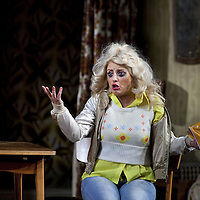 Louise McCarthy.<br /> <br /> Yer Granny - a new production by The National Theatre of Scotland opens at the Beacon arts Centre, Greenock, Scotland.<br /> <br /> <br /> Based on La Nona by Roberto Cossa<br /> In a new version by Douglas Maxwell<br /> Directed by Graham McLaren<br /> <br /> <br /> Picture by Drew Farrell<br /> Tel : 07721-735041<br /> Image offered on a speculative basis.<br /> <br /> Yer Granny is a riotous new comedy about a diabolical 100-year-old granny who&rsquo;s literally eating her family out of house and home. She&rsquo;s already eaten their fish and chip shop into bankruptcy and now she&rsquo;s working her way through their kitchen cupboards, pushing the Russo family to desperate measures just to survive beyond 1977.<br /> <br /> As proud head of the family, Cammy is determined that The Minerva Fish Bar will rise again and that family honour will be restored &ndash; and all in time for the Queen&rsquo;s upcoming Jubilee visit. But before Cammy&rsquo;s dream can come true and before Her Maj can pop in for a chat, a single sausage and a royal seal of approval, the family members must ask themselves how far they will go to solve a problem like Yer Granny.<br /> <br /> Adapted from the smash-hit Argentinian comedy classic La Nona, the cast of Yer Granny features some of Scotland&rsquo;s best-loved performers, including Gregor Fisher in the title role, alongside Paul Riley (Still Game), Jonathan Watson (Only An Excuse?), Maureen Beattie (Casualty), Barbara Rafferty (Rab C Nesbitt), Brian Pettifer (The Musketeers) and Louise McCarthy (Mamma Mia!, West End).<br /> <br /> Performance dates :<br /> The Beacon Arts Centre, Greenock<br /> 19/05/2015&nbsp;-&nbsp;21/05/2015 <br /> <br /> King's Theatre, Glasgow<br /> 26/05/2015&nbsp;-&nbsp;30/05/2015 <br /> <br /> King's Theatre, Edinburgh<br /> 02/06/2015&nbsp;-&nbsp;06/06/2015 <br /> <br /> Eden Court, Inverness<br /> <br /> Lyric Theatre, Belfast<br /> 23/06/2015&nbsp;-&nbsp;27/06/2015 <br /> <br /> Dundee Rep Theatre<br /> 30/06/2015&nbsp;-&nbsp;04/07/2015