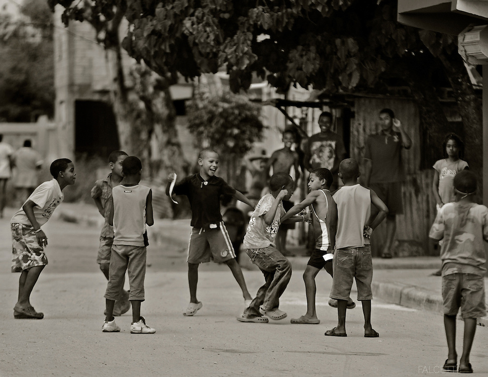 Hato Mayor del Rey, Dominican Republic-  Dominican children entertain themselves with a street fight in Hator Mayor del Rey. A recent ruling by the Constitutional Court in the Dominican Republic states Dominicans born after 1929 to parents who are not of Dominican ancestry are to have their citizenship revoked. The ruling affects an estimated 250,000 Dominican people of Haitian descent, including many who have had no personal connection with Haiti for several generations. (Photo by Robert Falcetti)