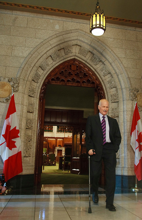 NDP leader Jack Layton arrives for a press conference in the foyer of the House of Commons in Ottawa, Canada following the fall of the Conservative government in a non confidence vote March 25, 2011. Canadians will be heading to the polls in May.<br /> AFP/GEOFF ROBINS/STR