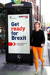 "© Licensed to London News Pictures. 02/09/2019. London, UK. A woman walks past a ""Get ready for Brexit"" digital advert on the back of a telephone box in north London.<br /> Today the UK Government launches a £100-million no-deal public information campaign with the slogan ""Get ready for Brexit"" as MPs attempt to delay Brexit. The campaign is hailed as the biggest government advertising drive since the Second World War. It is meant to ensure that businesses and the public are prepared in case Britain departs the EU without an agreement on October 31.<br /> Photo credit: Dinendra Haria/LNP"