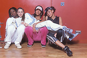 UK Grime/Garage mc Lady Sovreign, posing with friends in two piece adidas tracksuit, UK 2005