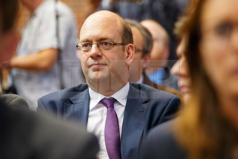 © Licensed to London News Pictures. 30/07/2015. London, UK. Ex-UKIP MP Mark Reckless listening UKIP leader Nigel Farage giving a speech on how the No campaign can win the EU referendum at Emmanuel Centre in central London on Thursday, July 30, 2015. Photo credit: Tolga Akmen/LNP