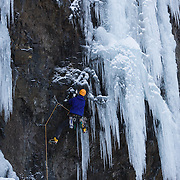 "Róbert Halldórsson on the first ascent of the ice climb "" Krókodílamaðurinn"" M6, 30m, at Breiðdalur. East Iceland."