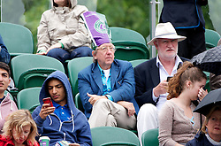 LONDON, ENGLAND - Thursday, June 27, 2013: Spectators shelter from the rain during the Ladies' Singles 2nd Round match on day four of the Wimbledon Lawn Tennis Championships at the All England Lawn Tennis and Croquet Club. (Pic by David Rawcliffe/Propaganda)