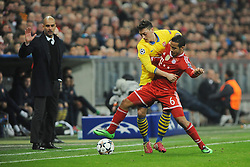11.03.2014, Allianz Arena, Muenchen, GER, UEFA CL, FC Bayern Muenchen vs FC Arsenal, Achtelfinale, Rueckspiel, im Bild Thiago Alcantara (FC Bayern Muenchen) im Duell mit Mesut Oezil (FC Arsenal) hinten Rechts Trainer Pep Guardiola (FC Bayern Muenchen) // during the UEFA Champions League Round of 16, 2nd Leg match between FC Bayern Munich and Arsenal FC at the Allianz Arena in Muenchen, Germany on 2014/03/11. EXPA Pictures © 2014, PhotoCredit: EXPA/ Eibner-Pressefoto/ Stuetzle<br /> <br /> *****ATTENTION - OUT of GER*****