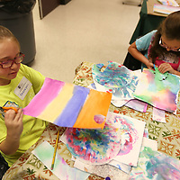 Brennan Davis, 8, of Saltillo, and Riley Grace Hollis, 7, of Tupelo, work on building their houses as they cut the shapes out from art they made as they attend art camp at the Ole Miss-Tupelo campus in Tupelo.