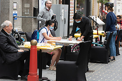 © Licensed to London News Pictures. 04/07/2020. London, UK. Customers eat and drink at outdoor restaurants tables in Chinatown after a relaxing of rules during the Covid-19 pandemic. Photo credit: Ray Tang/LNP.