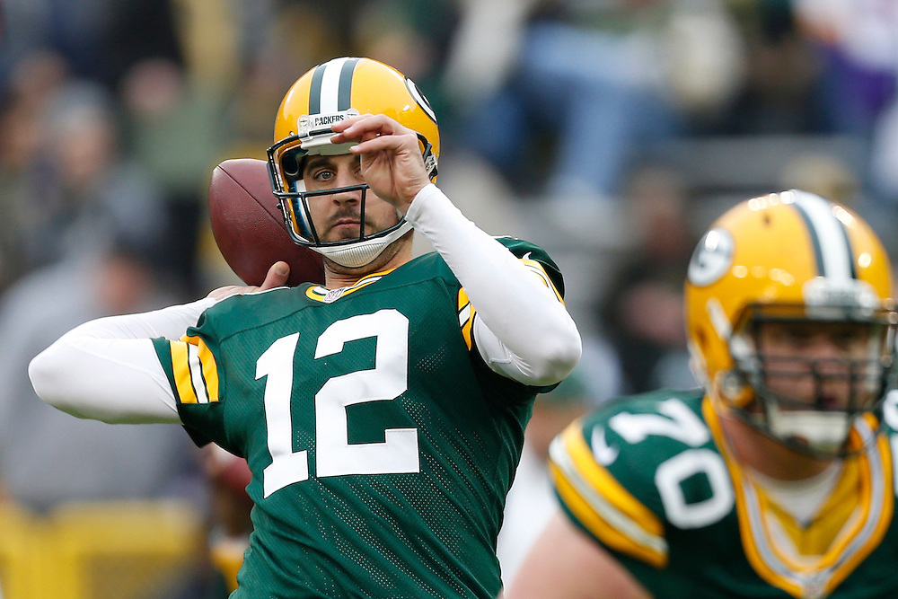 GREEN BAY, WI - DECEMBER 2:  Aaron Rodgers #12 of the Green Bay Packers warming up before a game against the Minnesota Vikings at Lambeau Field on December 2, 2012 in Green Bay, Wisconsin.  The Packers defeated the Vikings 23-14.  (Photo by Wesley Hitt/Getty Images) *** Local Caption *** Aaron Rodgers