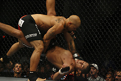 November 17, 2007; Newark, NJ, USA;  Thiago Silva (Camo Trunks) and Houston Alexander (red trunks) battle during their bout at UFC 78: Validation at the Prudential Center in Newark, NJ.  Silva won via 1st round KO.