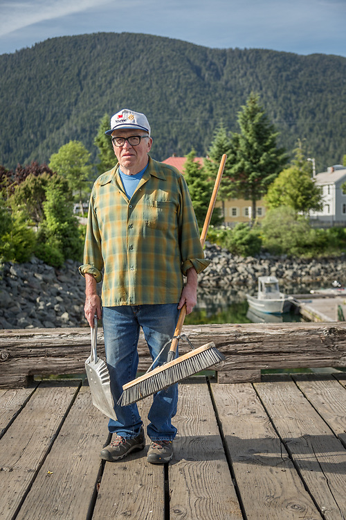 Charlie cleans up the dock after the annual crab feed in Sitka, Alaska.