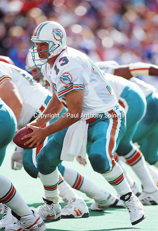 Miami Dolphins quarterback Dan Marino (13) takes a snap during the NFL football game against the Buffalo Bills on Oct. 9, 1994 in Orchard Park, N.Y. The Bills won the game 21-11. (©Paul Anthony Spinelli)
