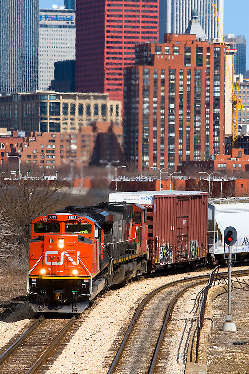 A brand new Canadian National locomotive leads it's train, navigating it's way through the city of Chicago on former Illinois Central track.