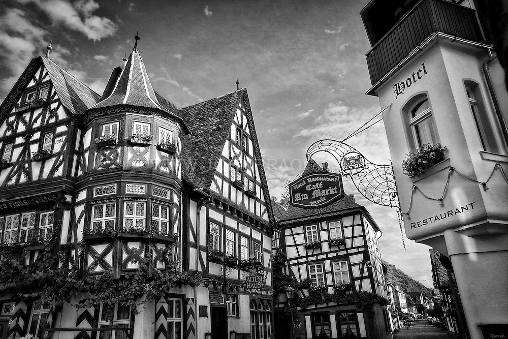 Black and white view of a Tudor style cafe and hotel in Bacharach, Germany