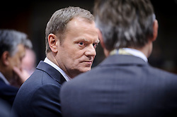 Donald Tusk, Poland's prime minister, speaks to a colleague during the first day of the EU Summit, at the European Council headquarters in Brussels, Belgium on Thursday, Dec. 13, 2012. (Photo © Jock Fistick)