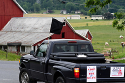 Caravan with activist drives over back country roads in Lancaster County, PA, on May 20, 2017 to protest the plans of a cross lighting of a Maryland based Ku Klux Klan chapter in QuarryVille, PA. A caravan, led by local activist Carter Farmer rode back country to protest the plans of a cross lighting of a Maryland based Ku Klux Klan chapter in QuarryVille, PA. The caravan was closely watched by locals as it drove passed as well as an unidentified individual who trailed it for some time.