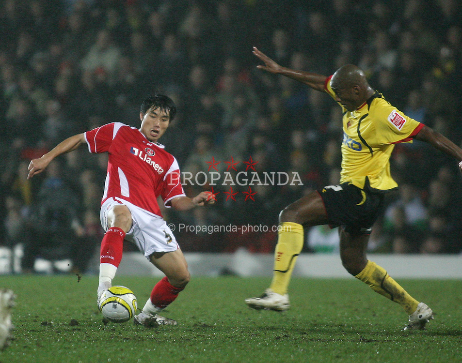 WATFORD, ENGLAND - Saturday, January 19, 2008: Charlton Athletic's Zheng Zhi in action against Watford's Damien Francis during the League Championship match at Vicarage Road. (Photo by Chris Ratcliffe/Propaganda)