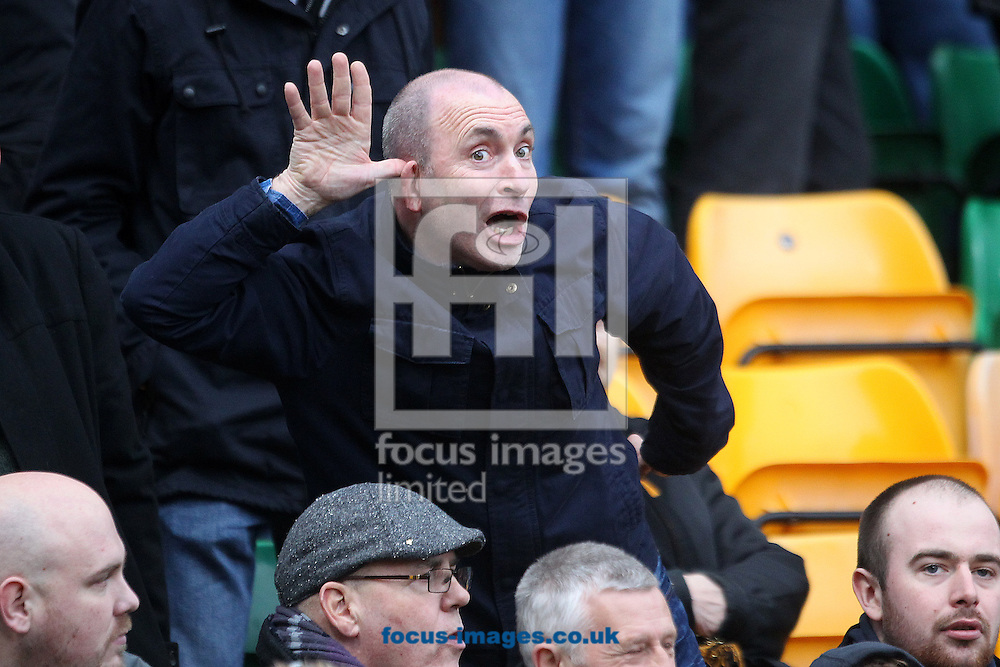 The Wolves fans taunt the home fans during the Sky Bet Championship match at Carrow Road, Norwich<br /> Picture by Paul Chesterton/Focus Images Ltd +44 7904 640267<br /> 14/02/2015